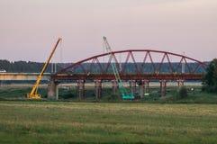 Dismantling the old bridge in the Kaluga region of Russia on the Ugra river. The Ugra river there are several large bridges on motorways. Some bridges have Stock Image