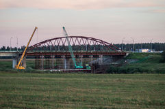 Dismantling the old bridge in the Kaluga region of Russia on the Ugra river. The Ugra river there are several large bridges on motorways. Some bridges have Stock Photos