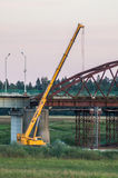Dismantling the old bridge in the Kaluga region of Russia on the Ugra river. The Ugra river there are several large bridges on motorways. Some bridges have stock photography