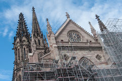 Dismantling the scaffolding after the renovation of the facade of the temple st Etienne Royalty Free Stock Photography