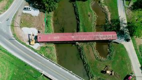 Dismantling of a 174 Year Old Burr Arch Truss Design Covered Bridge, Dual Span in the Pennsylvania Dutch Country stock video footage