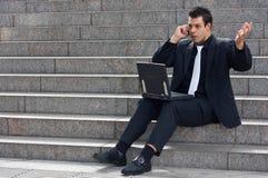 Dismayed business man Stock Image