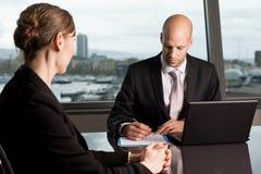 Dismissal. Businessman sacking a female worker stock photo