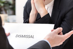 Dismissal at work. Business meeting and dismissal, people in suits Stock Photo