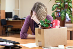 Dismissal at work, weeping employee Royalty Free Stock Images