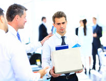 Dismissed businessman carrying box stock photography
