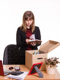 Dismissed girl in office goes through personal belongings Stock Images