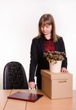 Dismissed girl in office with laptop closes collected things Royalty Free Stock Photos