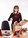 Dismissed girl in office throws their stuff a box Stock Photos