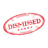 Dismissed grunge rubber stamp. Red grunge rubber stamp with the text dismissed written inside the stamp Stock Photos
