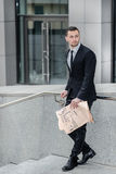 Dismissed. Handsome successful businessman holding a business ne Royalty Free Stock Photo