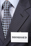 Dismissed person. A fragment of the official suit with badge on it Royalty Free Stock Image