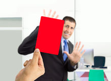 Dismissed with a red card. Businessman fired by his boss with a red card royalty free stock images