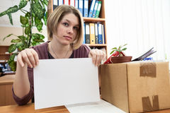 Dismissed worker with blank sheet of paper Stock Images
