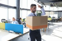 Free Dismissed Worker Going From The Office With His Office Supplies Showing Fuck Royalty Free Stock Image - 175683196