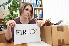 Dismissed worker with sheet of paper with fired word Royalty Free Stock Photo