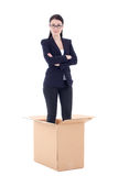 Dismission concept - business woman in cardboard box isolated on Royalty Free Stock Photos