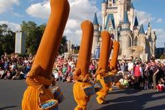 Disney brooms (Fantasia movie) during a parade. December 2007, Disney Magic Kingdom (Orlando) - Disney brooms from Fantasia 2000 movie with Cinderella castle in royalty free stock images