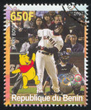 Disney Caharacter and Olympic Rings. BENIN - CIRCA 2007: stamp printed by Benin, shows Barry Bonds, Disney Caharacter and Olympic Rings, circa 2007 Stock Photo