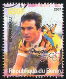 Disney Caharacter and Olympic Rings. BENIN - CIRCA 2007: stamp printed by Benin, shows Bernard Hinault, Disney Caharacter and Olympic Rings, circa 2007 Royalty Free Stock Photography