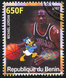 Disney Caharacter and Olympic Rings. BENIN - CIRCA 2007: stamp printed by Benin, shows Michael Jordan, Disney Caharacter and Olympic Rings, circa 2007 Royalty Free Stock Photo