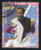 Disney Caharacter and Olympic Rings. BENIN - CIRCA 2007: stamp printed by Benin, shows Pete Sampras, Disney Caharacter and Olympic Rings, circa 2007 Stock Photos