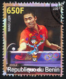 Disney Caharacter and Olympic Rings. BENIN - CIRCA 2007: stamp printed by Benin, shows Wang Liqin, Disney Caharacter and Olympic Rings, circa 2007 Royalty Free Stock Photos