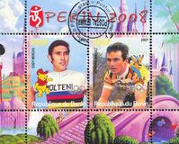 Disney Caharacter and Olympic Rings. BENIN - CIRCA 2007: stamp printed by Benin, shows Eddy Merckx, Disney Caharacter and Olympic Rings, circa 2007 Stock Image