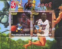 Disney Caharacter and Olympic Rings. BENIN - CIRCA 2007: stamp printed by Benin, shows Michael Jordan, Disney Caharacter and Olympic Rings, circa 2007 Royalty Free Stock Image