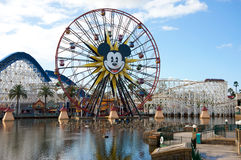 Disney California Adventure. Anaheim, California, USA - November 21, 2010: Disney California Adventure wheel with an image of Mickey Mouse and a roller coaster Royalty Free Stock Images