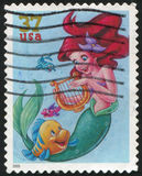 Disney cartoon. UNITED STATES - CIRCA 2005: stamp printed by United states, shows cartoon, Disney Characters, Flounder, Ariel, circa 2005 stock photography