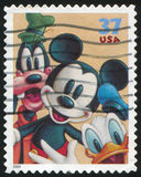 Disney cartoon. UNITED STATES - CIRCA 2004: stamp printed by United states, shows cartoon, Disney Characters, Goofy, Mickey Mouse, Donald Duck, circa 2004 Royalty Free Stock Photos