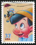 Disney cartoon. UNITED STATES - CIRCA 2004: stamp printed by United states, shows cartoon, Disney Characters, Jiminy Cricket, Pinocchio, circa 2004 Stock Image
