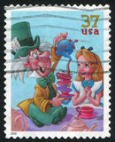 Disney cartoon. UNITED STATES - CIRCA 2005: stamp printed by United states, shows cartoon, Disney Characters, Mad Hatter, Alice, circa 2005 stock images