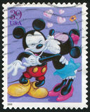 Disney cartoon. UNITED STATES - CIRCA 2006: stamp printed by United states, shows cartoon, Disney Characters, Mickey and Minnie Mouse, circa 2006 Royalty Free Stock Images