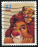 Disney cartoon. UNITED STATES - CIRCA 2004: stamp printed by United states, shows cartoon, Disney Characters, Mufasa, Simba, circa 2004 stock photography