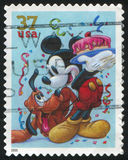 Disney cartoon. UNITED STATES - CIRCA 2005: stamp printed by United states, shows cartoon, Disney Characters, Pluto, Mickey Mouse, circa 2005 royalty free stock image