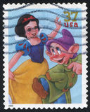 Disney cartoon. UNITED STATES - CIRCA 2005: stamp printed by United states, shows cartoon, Disney Characters, Snow White, Dopey,  circa 2005 Stock Photography