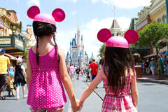 Disney Castle. Two young girls in front of the Disney Cinderella Castle wearing Mickey Ears holding hands Royalty Free Stock Images