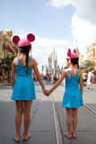 Disney Castle. Sisters holding hands walking down main street to Disney Castle in Florida royalty free stock images
