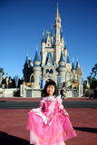 Disney Castle. Young girl in front of disney magical castle royalty free stock photo
