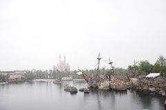 Disney Castle and pirates of the caribbean in Disneyland Park in Shanghai Stock Photos