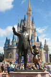 Disney Castle and Walt Disney. Cinderella Disney Castle on a sunny day with blue sky and white clouds