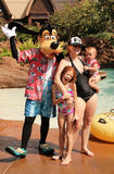 Disney Character Goofy. With a mother and two children at a Disney Resort Stock Photos