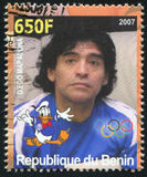 Disney Character and Olympic Rings. BENIN - CIRCA 2007: stamp printed by Benin, shows Diego Maradona, Disney Caharacter and Olympic Rings, circa 2007 Stock Photography