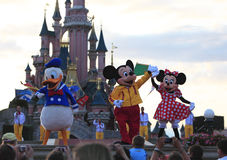 Disney characters. (Mickey Mouse, Donald Duck and Minnie Mouse) performing on a stage in front of the Princesses Castle in Disneyland Paris Stock Photography