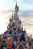 Disney characters. Performing on a stage in front of the Princesses Castle in Disneyland Paris during the evening Stock Photo