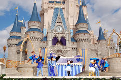Disney characters at Cinderella castle. August 2007, Magic Kingdom (Orlando) - Disney characters dancing at Disney Cinderella castle under a blue  sky with white Stock Image