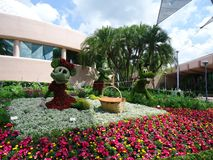 Disney characters made in flowers at Disneyland in Orlando Florida. Mickey Minnie. Nature art sculpture traveler tourist tourism entertainment United States stock photography
