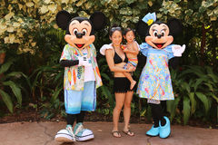 Disney Characters Minnie and Mickey Mouse. Disney Characters, Minnie and Mickey Mouse with a young mother and her child at a Disney Resort Royalty Free Stock Image